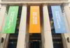 Banners hang on a building at Johns Hopkins University